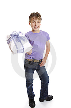 Young Boy Holding Present Stock Photo - Image: 8973240