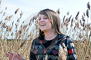 Young Girl Laughing In Field Royalty Free Stock Photo - Image: 8974625