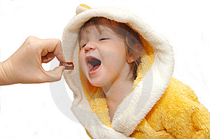 The Little Girl Eats A Sweet Stock Photography - Image: 8978132