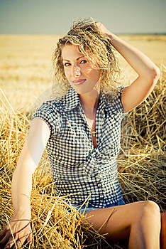 Country Girl Sitting On The Haystack Royalty Free Stock Photos - Image: 8980938
