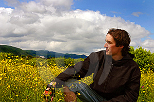 Young Man On Yellow Meadow In Sunny Weather Royalty Free Stock Photography - Image: 8981207