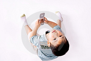 Boy Looking Upward With Cell Phone Royalty Free Stock Image - Image: 8993196