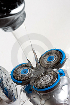 Macro Of Shaver Head Under Tap Royalty Free Stock Image - Image: 8993576