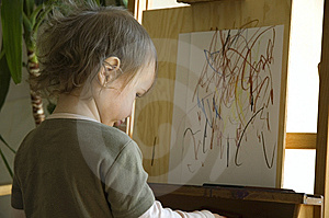 Small Girl Drawing At A Wooden Easel Royalty Free Stock Images - Image: 8998129