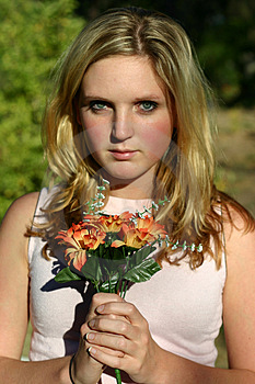 Woman Holding Flowers Free Stock Photo