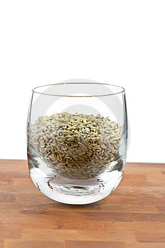 Dried Fennel Seeds In Glass On Wooden Table Royalty Free Stock Images - Image: 9009839