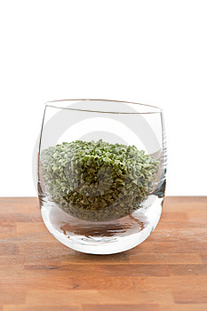 Dried Chive In Glass On Wooden Table Stock Images - Image: 9009844