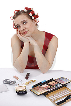 Woman With Hair-rollers Thinks About Something. Stock Photography - Image: 9011272