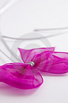 Pink Bow Tie Ribbon With Silver Cord Stock Photo - Image: 9012600