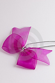 Pink Bow Tie Ribbon With Silver Cord Stock Image - Image: 9012621
