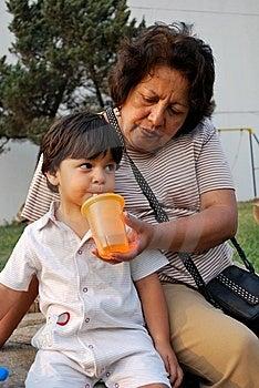 Grandmother Feeding Her Grandson Water Royalty Free Stock Photos - Image: 9013428