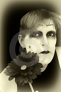Gloomy Mime With  Red Flower Stock Photography - Image: 9022172