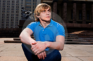 Blond Man Sitting Outdoors Royalty Free Stock Images - Image: 9023789