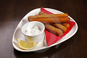 Roasted Cheese Sticks On White Plate Royalty Free Stock Image - Image: 9029876