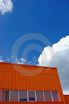 Orange Building With Cloudy Sky Stock Photos - Image: 9034223