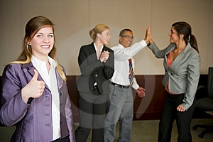 Team Celebration With Woman In Foreground Royalty Free Stock Image - Image: 9035026