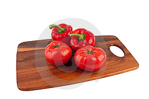 Tomatoes And Peppers On Cutting Board Royalty Free Stock Photo - Image: 9041485