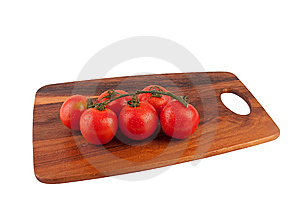 Bunch Of Tomatoes On Cutting Board Royalty Free Stock Photography - Image: 9041507