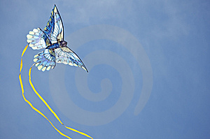 Blue Kite Arcing Against The Sky Royalty Free Stock Photo - Image: 9046475