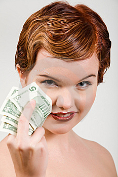 Red-head Woman With Dollar Strasses Royalty Free Stock Image - Image: 9049526