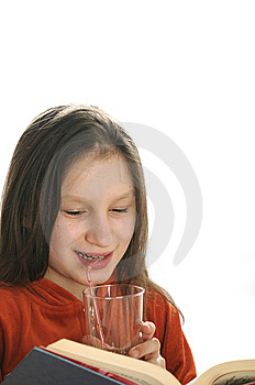 Reading Girl With Glass Of Juice Stock Photos - Image: 9051023
