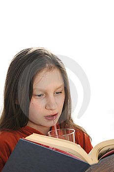 Reading Girl With Glass Of Juice Royalty Free Stock Image - Image: 9051026