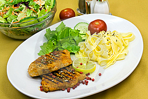 Grilled Pork Steak With Noodles And Lettuce Stock Image - Image: 9052401