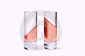 Thin Glasses With Pink Liquid Stock Images - Image: 9057304