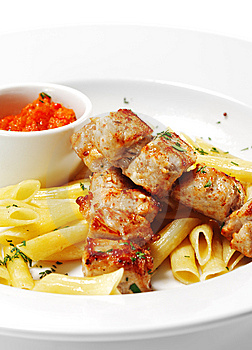 Hot Meat Dish - Grilled Pork With Pasta Penne Royalty Free Stock Photo - Image: 9060325