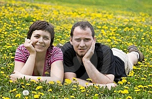 Couple laying in a meadow Royalty Free Stock Photos