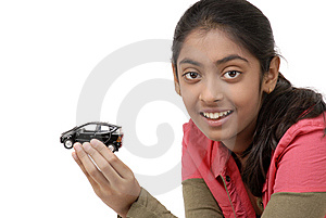 Young Girl Holding Her Dream Car Model Royalty Free Stock Photo - Image: 9068605