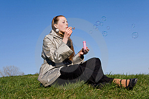 Girl Makes Soap Bubble Stock Photo - Image: 9070440