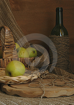 Still-life With Apples, A Basket And A Bottle Stock Photo - Image: 9073080