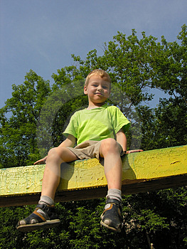 Child on log Stock Photography