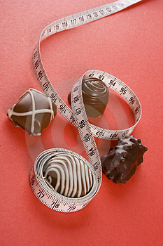 Some Of Chocolates And The Measure Royalty Free Stock Image - Image: 923646