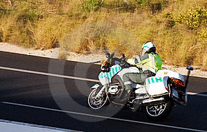 Police Biker In Hot Pursuit Stock Images - Image: 9214354