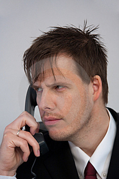 Businessman Answering Phone Royalty Free Stock Images - Image: 9227739