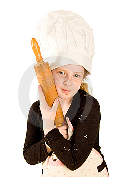 Cook Wearing A Chefs Hat Is Holding A Rolling Pin Royalty Free Stock Image - Image: 9239326