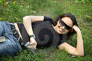 Beautiful Girl Lies On The Grass Royalty Free Stock Photography - Image: 9244297