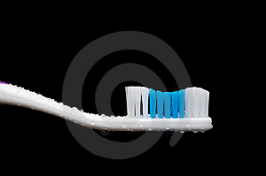 A Manual Toothbrush With Water Droplets Royalty Free Stock Image - Image: 9245686