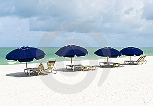 Lounge Chairs And Parasols On A Pristine White Sand Stock Photos - Image: 9253603