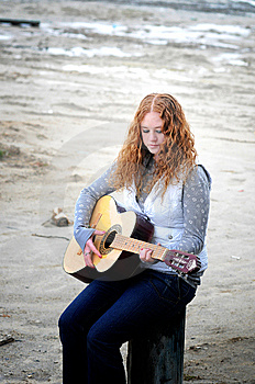 Girl By The Sea With Her Guitar Stock Photo - Image: 9255450