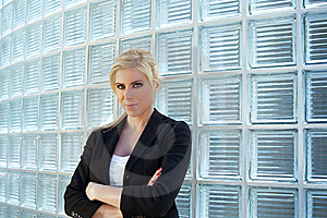 Business Woman Leaning On Glass Bricks Royalty Free Stock Images - Image: 9256489