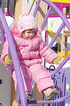 Baby Have A Good Time On Attraction In Park Royalty Free Stock Photography - Image: 9263947