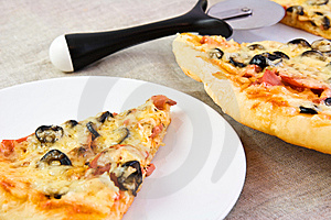 Fresh Pizza On A White Plate And A Linen Cloth Stock Photos - Image: 9265193