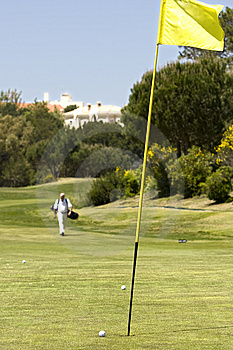 Green Golf Field Showing The Hole And The Flag Royalty Free Stock Photos - Image: 9266498