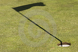 Golf Field Showing The Hole And The Flag Shadow Royalty Free Stock Photos - Image: 9266538