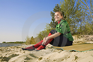 Girl Sitting On Sea Coast Stock Images - Image: 9268054