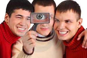 Three Friends Look Through Magnifier Royalty Free Stock Image - Image: 9290506