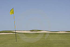 Green Golf Field Showing A Yellow Flag Royalty Free Stock Image - Image: 9292536